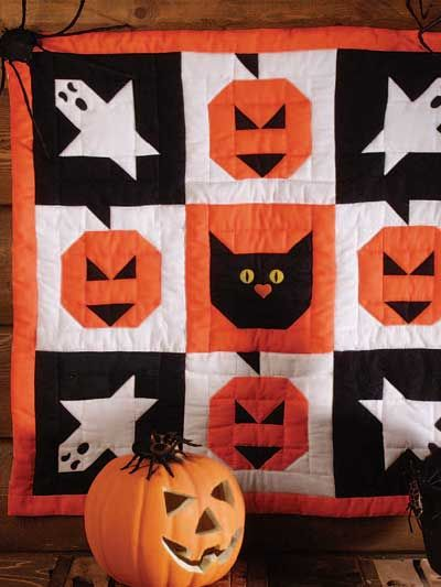 "Create a Halloween Wall Quilt FREE download... ...featuring ghosts, pumpkins and a cat made with the quick cutting and piecing methods included in this free quilt pattern. Finished Quilt Size: 30"" x 30"". Block Size: 9"" x 9""."