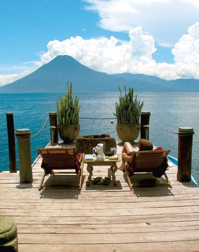 "Laguna Lodge  Lake Atitlán, Guatemala   ""the most surreal sunsets I've ever seen—pink and vivid and misty—as the sun dropped behind the tops of the volcanoes."""