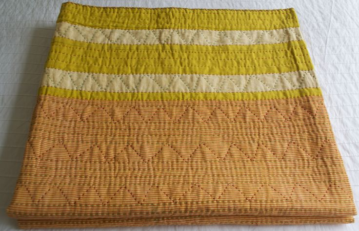 Orange pin stripe quilt with complementary orange and green kantha stitching throughout the textile. Lightweight 3 layers of Indian cotton. Size 220 x 240 cm King/Queen