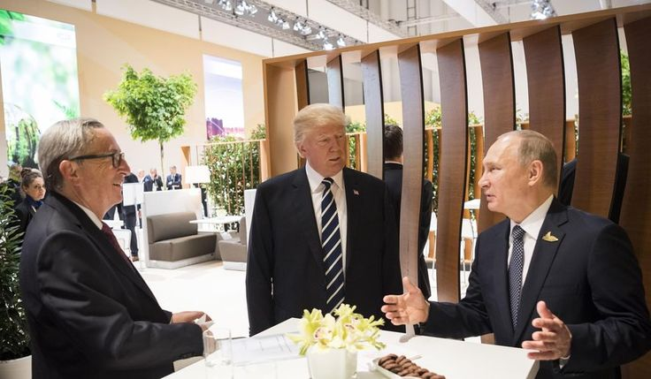 In this photo provided by German government U.S. President Donald Trump, center, talks to Russian President Vladimir Putin and European Commission President Jean-Claude Juncker, left, before the first working session of the G-20 summit in Hamburg, northern Germany. (Steffen Kugler/Presse- und Informationsamt der Bundesregierung via AP)