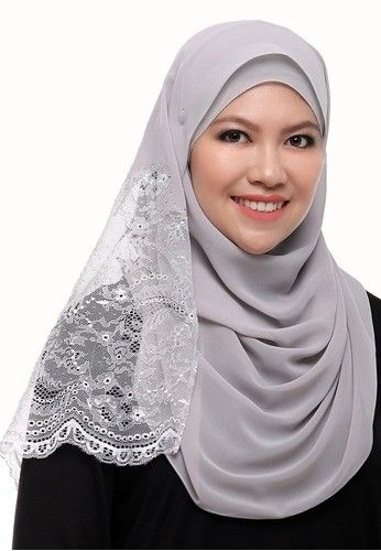 Anisa Silk Lace Shawl from Secretcode in Grey Anisa Silk Lace Shawl is an exclusive shawl featured with embroidered lace attached at one side of the shawl. Made of Chiffon Silk fabrics that will absolutely giving the luxurious look. Add the modest yet exclusive accessories on your attire by wear...