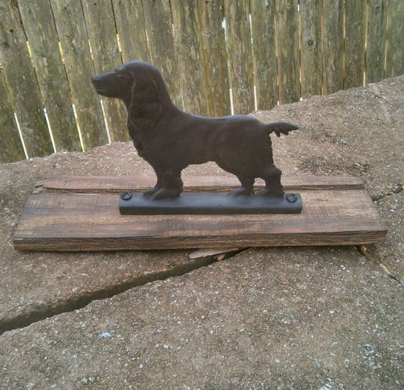 With its sincere eyes and stance, this lovable dog is surely a Cocked Spaniel or a Cavalier breed. An old black metal boot scraper affixed to a piece of rustic wood, a fabulous addition to your front porch, patio or garden. The metal piece can be removed from the wood and attach to the top of fence or gate. Or simply use as a decorative piece on the floor, hearth, shelf, etc. MEASURES: Overall; 13L x 4W x 6 -1/4H, Metal Dog; 6 -1/2L x 5 -3/4H.  Condition; metal is securely atta...