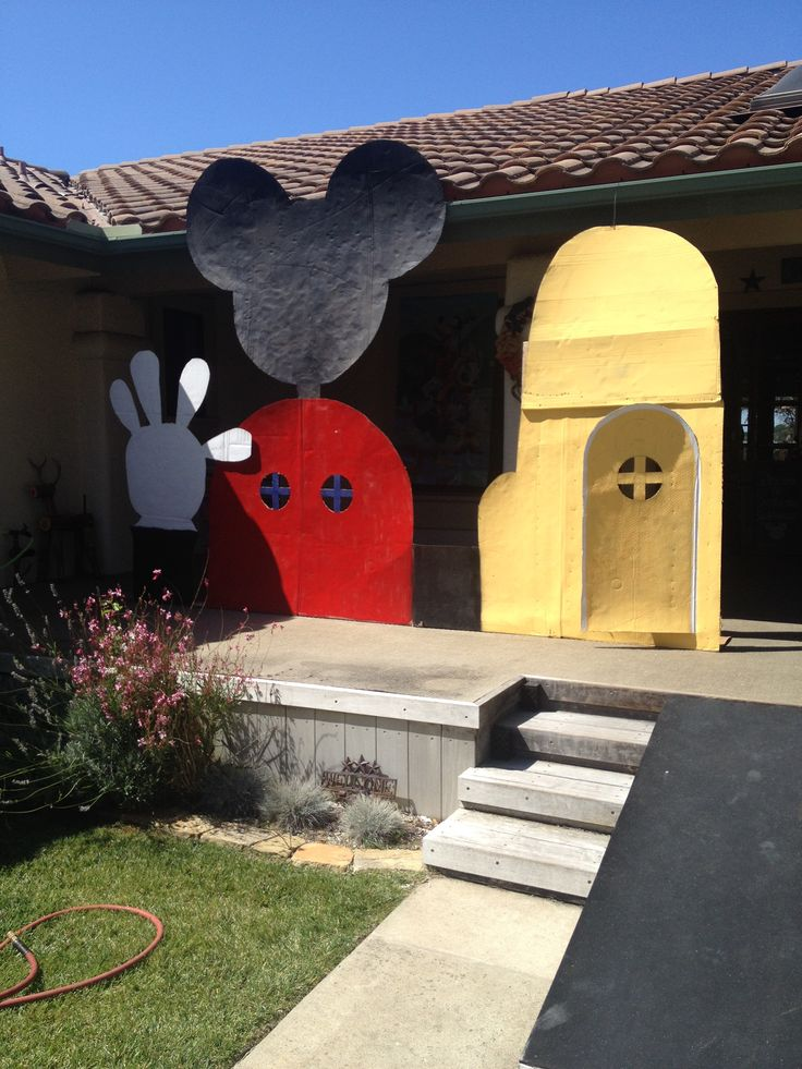 DIY Mickey Mouse Clubhouse we made for my grandson's 2nd birthday party - cardboard, paint and strips of wood in the back for support
