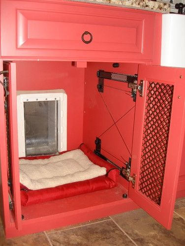 Dog Door. Could lock the cabinet when not home and dog could still come and go.