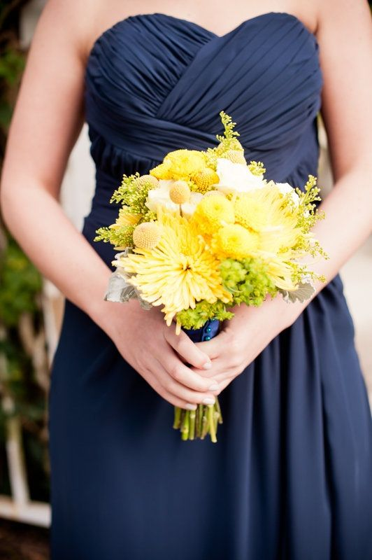 How I want my wedding to be like! Navy blue dresses and yellow flowers! :)