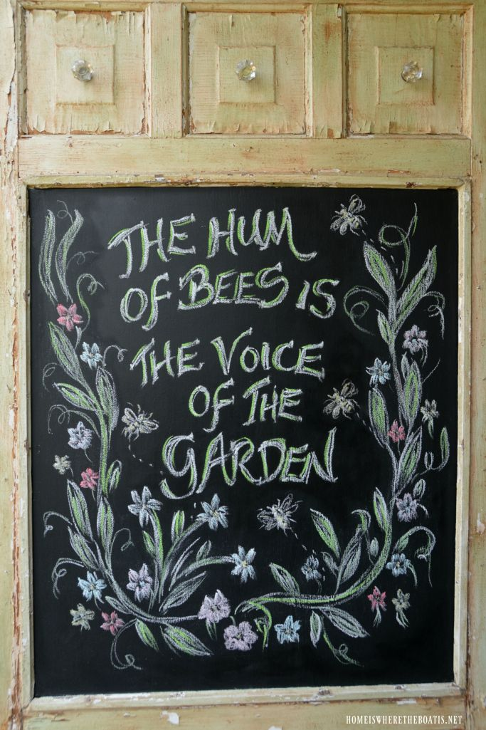 Chalkboard door on Potting Shed: The Hum of Bees is the Voice of the Garden | homeiswheretheboatis.net #flowers #sheshed