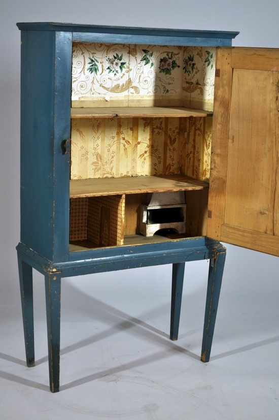 What a great idea! homemade doll house out of an old cabinet. Easy cleanup.
