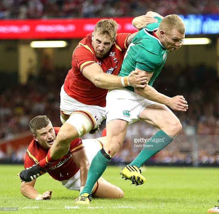 Keith Earls of Ireland breaks away from Dominic Day during the International match between Wales and Ireland at the Millennium Stadium on August 8, 2015 in Cardiff, Wales.