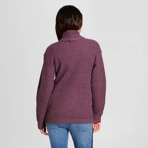 Layer on some warm and cozy style with the Textured Open Layering Cardigan from A New Day™. This open-front cardigan layers well over a variety of tops so you can keep wearing your favorite tees and tank tops when the temperatures start to cool. Add to a striped tee, distressed jeans and booties for a look that can take you just about anywhere.