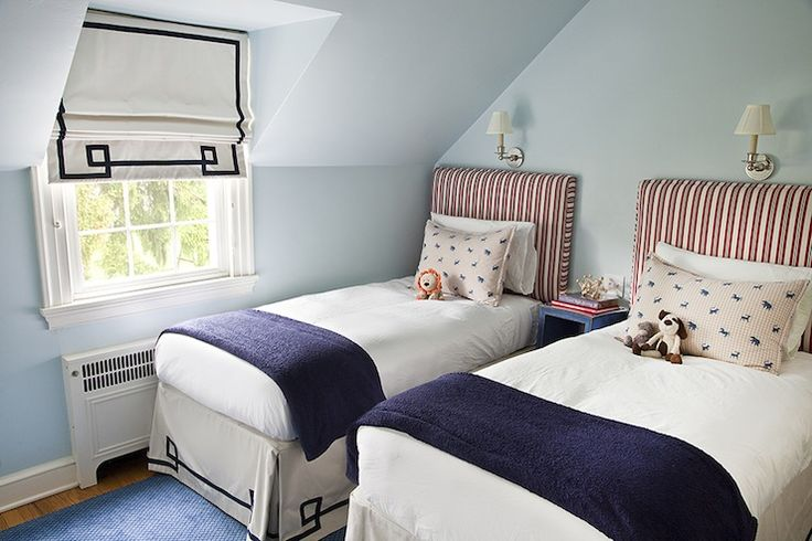 Greek key bedskirts w/ matching roman shade & coordinating bedding make this a perfect space for a little boy!