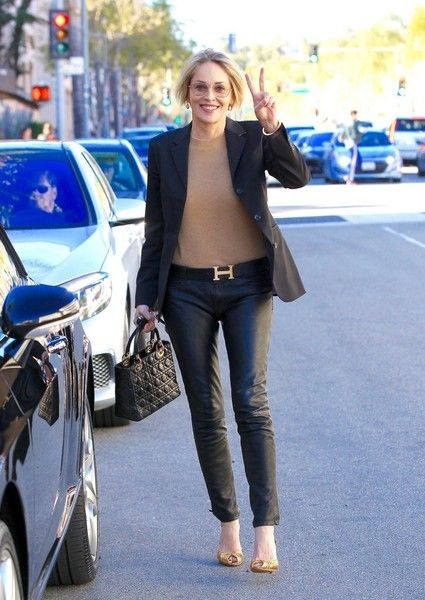 Sharon Stone Photos Photos - Actress Sharon Stone was seen leaving a lunch date with a friend in Beverly Hills, California on February 24, 2017. Sharon seems very jubilant as she can be seen throwing up a peace sign as she gets in her car - Sharon Stone Dines Out In Beverly Hills