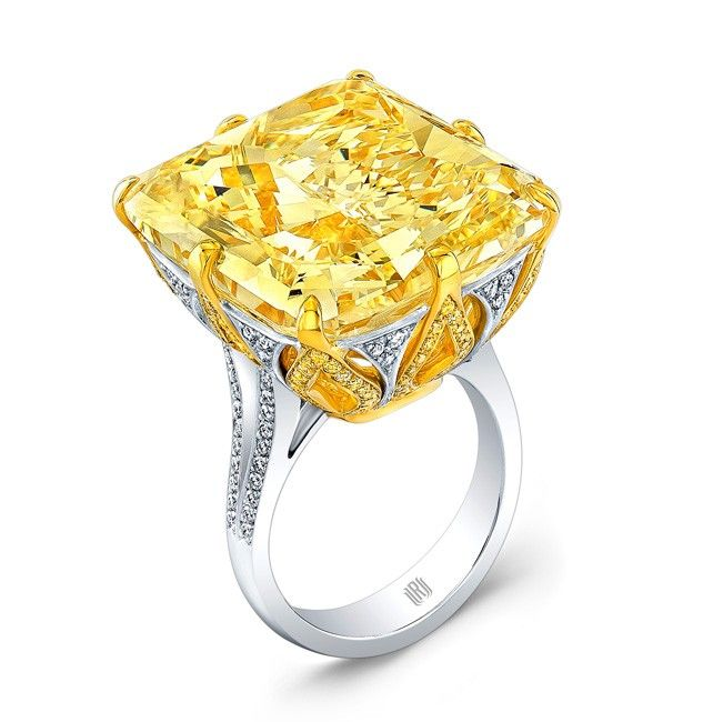 The Golden Majesty - Our magnificent Fancy Yellow Radiant diamond accented with both FY and white melee diamonds set in Platinum and 18k yellow gold.