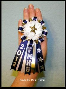 """Finger Mums: The mum flower on the finger mums is a 2"""" 9 layer flower and she used triple ribbon backing. It comes with the year and school on the ribbons. She used stretchy sequins for the band so it makes it more comfortable and pretty!! via vintagescrapping.typepad.com"""