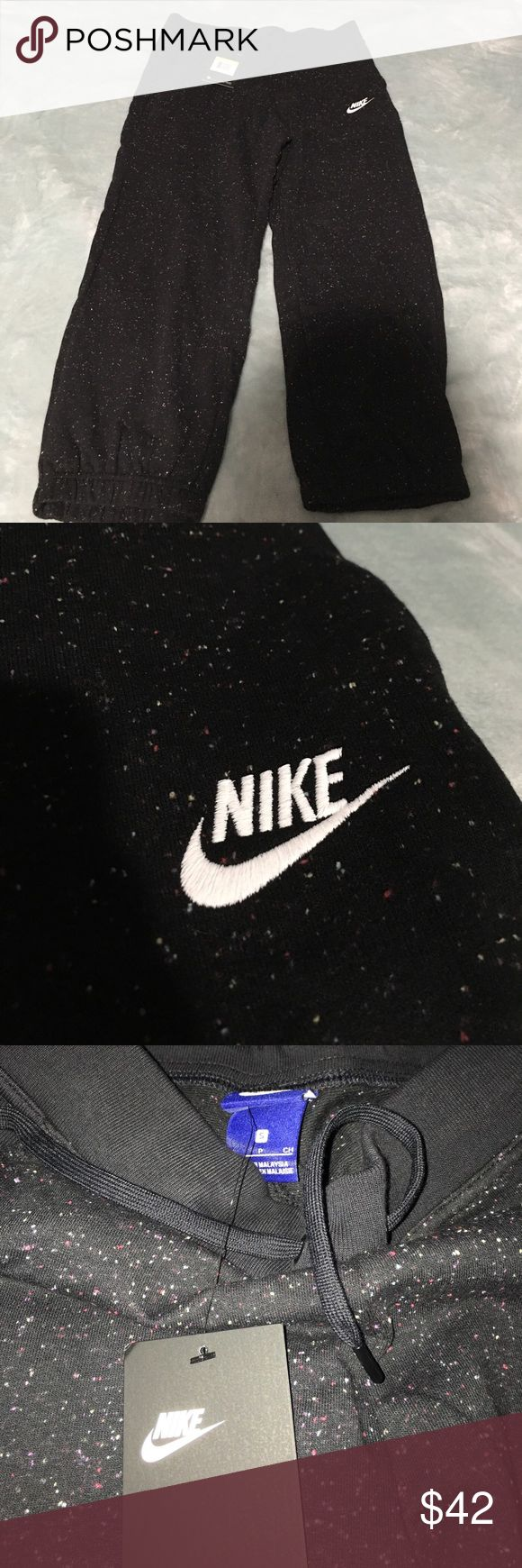 Nike capris Brand new with tag, black with confetti coloring on them, has two pockets Nike Pants Capris