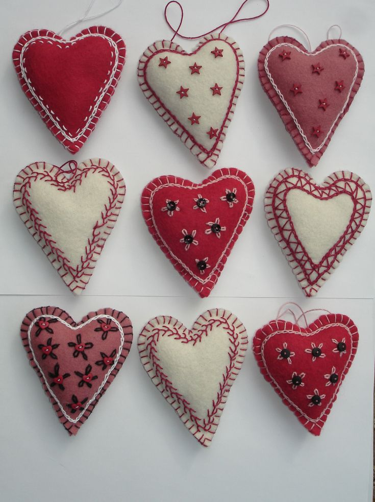 Hand-embroidered felt hearts  by Joanne Harper,  MyDisgustedCats