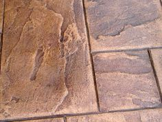 Slip-Resistant Stamped Concrete. This article gives good advice about adding a grit to the sealer to help give it grip vs. slip!