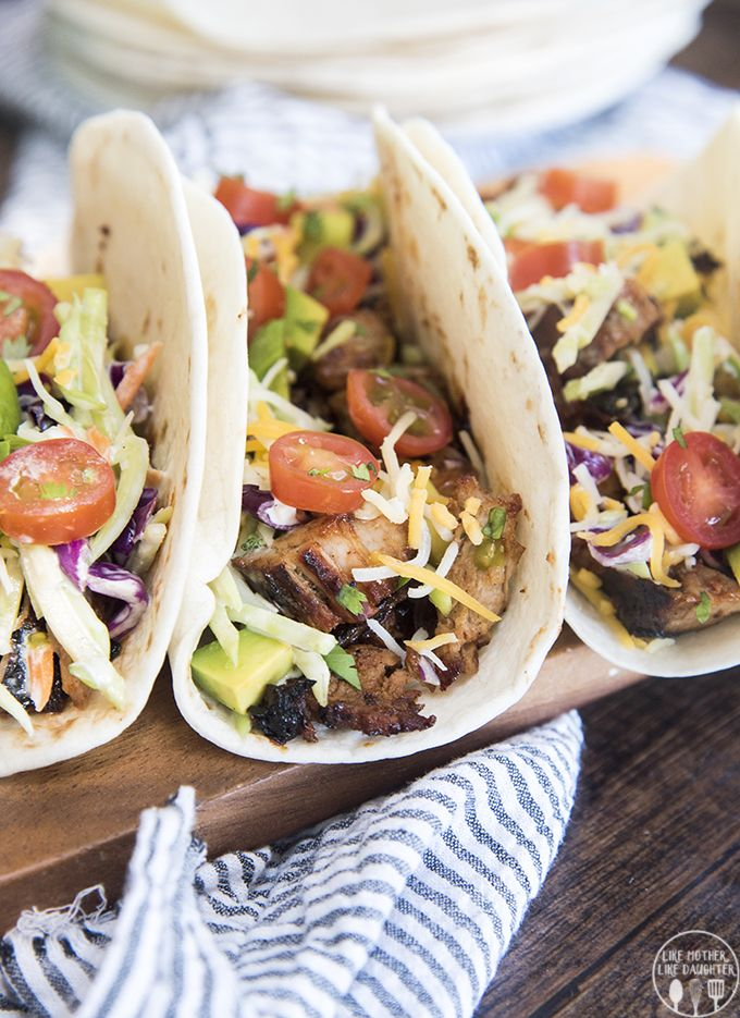 BBQ Pork Tacos - These BBQ Pork Tacos are topped with a delicious creamy broccoli slaw, tomatoes, shredded cheese and your favorite…
