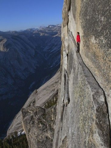 A climber walks a 40-foot-long sliver of granite on Half Dome, named the Thank God Ledge. Photographic Print by Jimmy Chin - at AllPosters.com.au