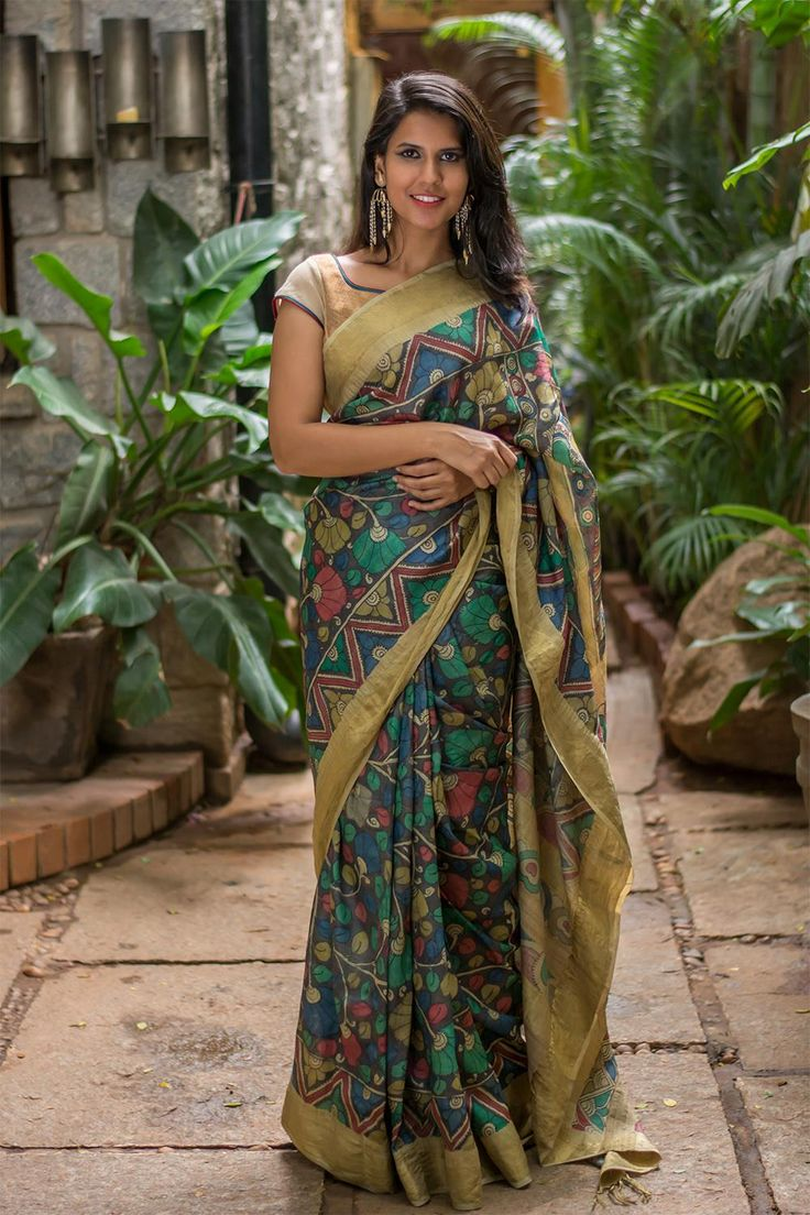 This printed muted black heavy weight tussar with dull gold border is for those who do not want a loud statement. Donning a toned down color demands an attitude on its own and this saree gives you just enough oomph to make that happen. Pair her with a copper toned brocade blouse to finish off the look. ACCOMPANIMENTS: All sarees are sold completely finished with falls (where required), a finished pallu with tassles and a free size underskirt. Comes with a blouse piece. FABRIC: Saree – ...