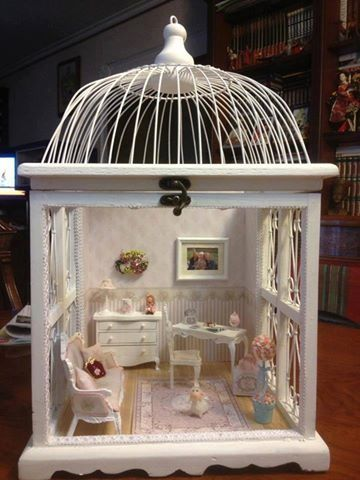 Salvaged birdcage and meticulous upcycling = dollhouse.