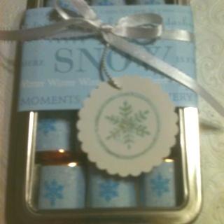 Christmas tin; holds 10 Hershey nuggets.