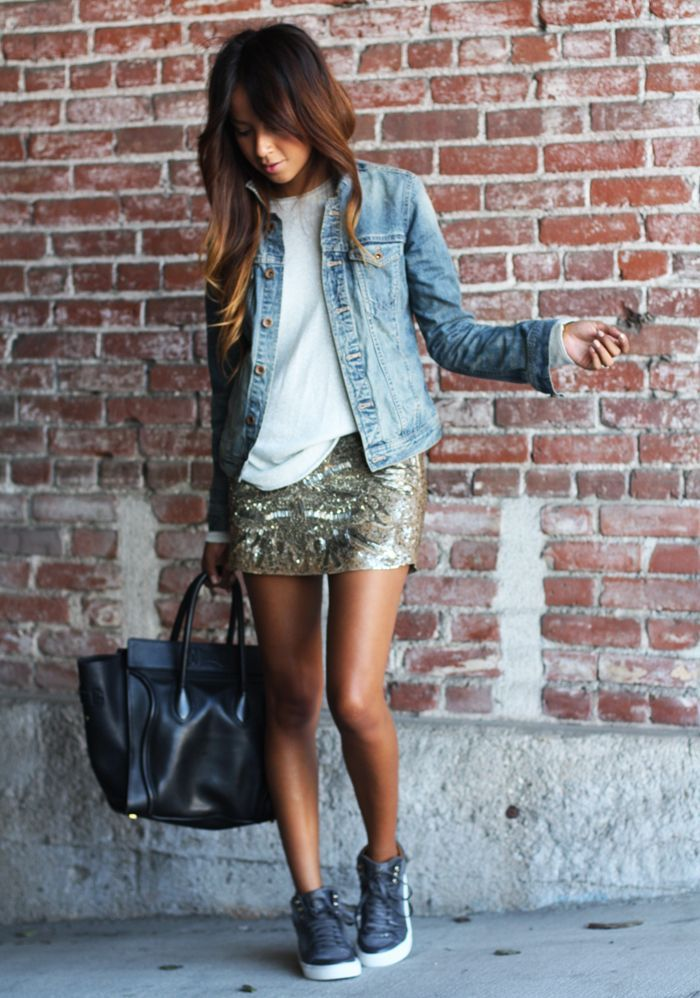 Reach for a light blue denim jacket and a gold graphic sequin mini skirt for a casual get-up. For a more relaxed take, rock a pair of dark grey high top sneakers.  Shop this look for $60:  http://lookastic.com/women/looks/long-sleeve-t-shirt-denim-jacket-mini-skirt-tote-bag-high-top-sneakers/6784  — White Long Sleeve T-shirt  — Light Blue Denim Jacket  — Gold Print Sequin Mini Skirt  — Black Leather Tote Bag  — Charcoal High Top Sneakers