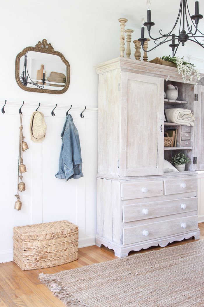 Step inside this beautiful Indiana farmhouse entryway decorated with a mix of…