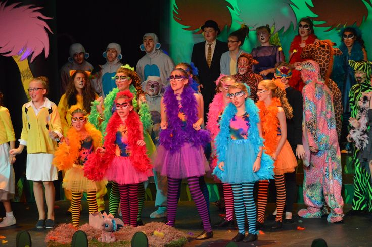 Seussical Jr bird girl makeup using mehron face paint and feathers glued to their foreheads using spirit gum.