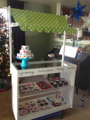 Here's the cupcakery/bakery we made for our girls. It was so much fun to make. My husband focused on the stand and I worked on the canopy and all the felt food.  We listed LOTS of pictures for anyone who wants to make their own to follow.