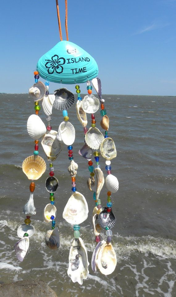 This wind chime is unique in that it has glass beads as well as shells in its strands. The base clam shell is painted and has on Island Time