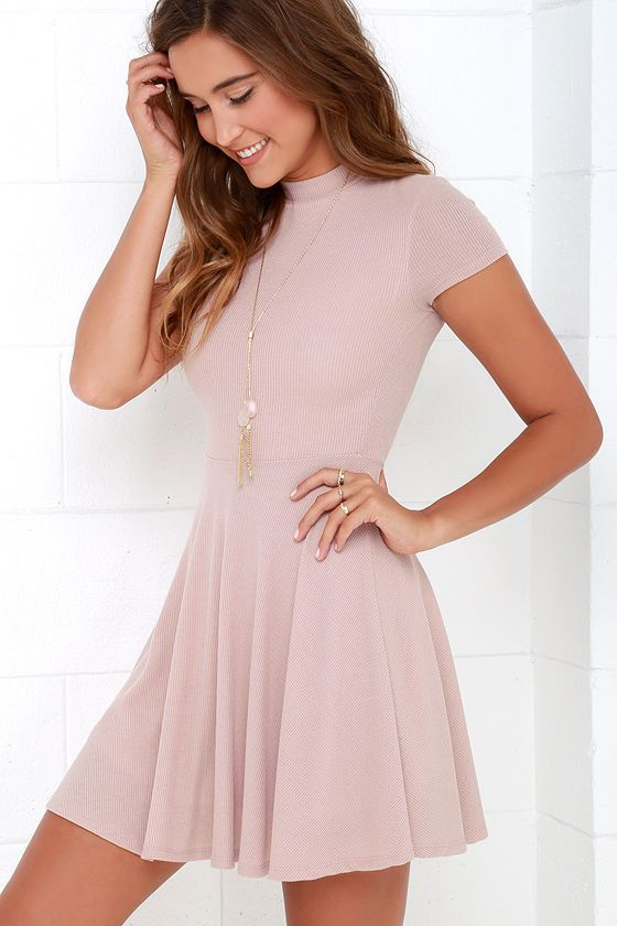When you're looking to wear something so comfy that you can wear it all day and through the night, pick the Endless Entertainment Blush Short Sleeve Skater Dress! Soft and lightweight ribbed knit fabric shapes a mock neckline and short sleeves that frame a fitted bodice and waistline. From there, a flouncy skater skirt descends, perfect for a twirl on the dance floor! Dress is lined; sleeves are not. 91% Rayon, 9% Spandex. Dry Clean Only.