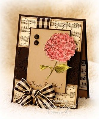 handmade card ,,, luv the use of the big ribbon ... sheet music ... black with kraft ... hibiscus colored in dusty reds ... great inspiration!