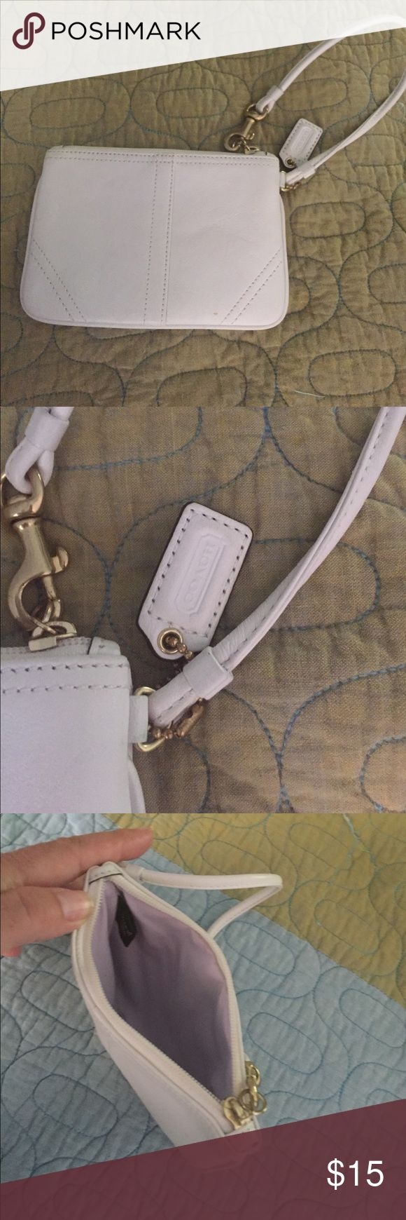 Coach wristlet White leather wristlet. Shows no wear. Great condition...cute Coach Bags Mini Bags