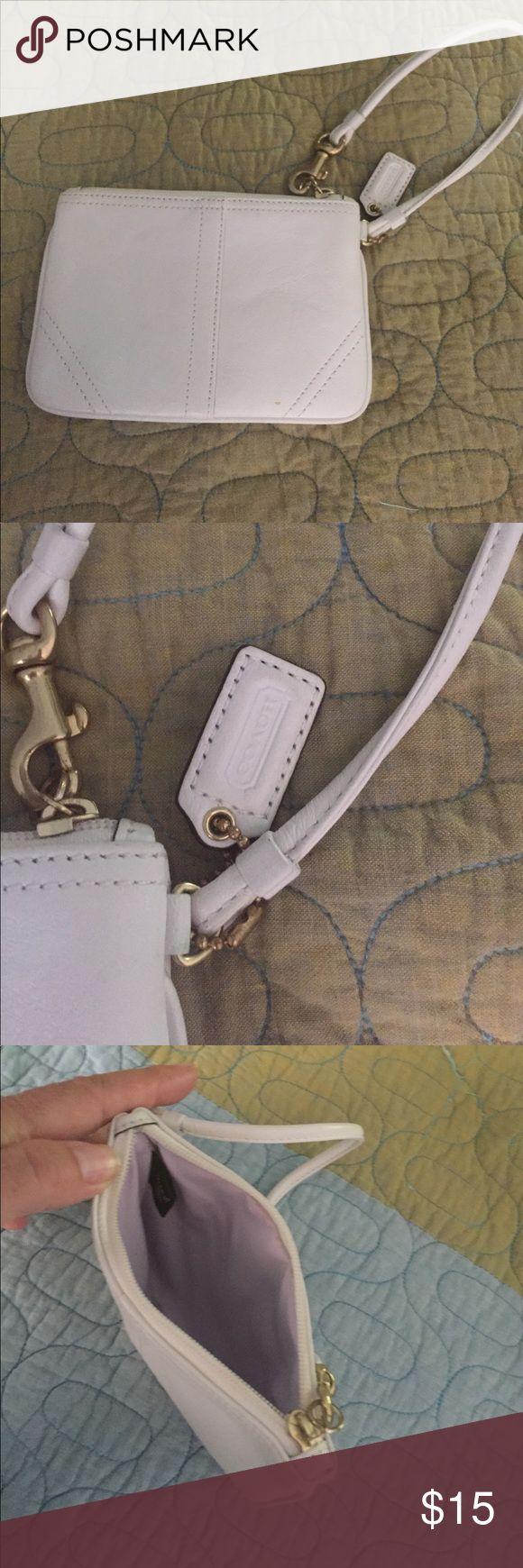 Coach wristlet White leather wristlet. Shows no wear. Great condition...cute Coach Bags Mini Bags