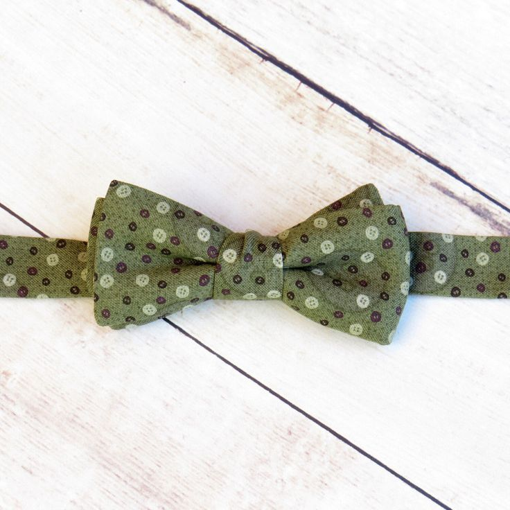 Baby Boy Bow Tie  Olive Green Button Bow Tie   Cotton Bow Tie   Adjustable Strap Bow Tie   Boy Kid Bow Tie  Ring Bearer Bow Tie by SuperBowDesign on Etsy https://www.etsy.com/uk/listing/477666376/baby-boy-bow-tie-olive-green-button-bow