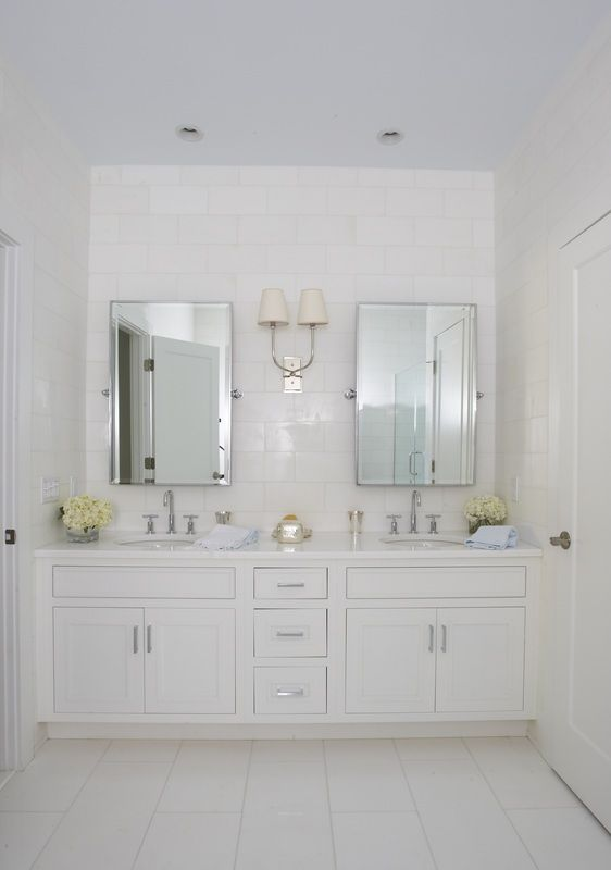 White On White Single Sconce In Between Two Mirrors White Bathroom Trendy Bathroom