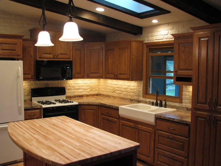 1970s split level kitchen remodel  Oak cabinets farm