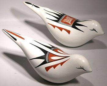 Jemez Pottery Birds :: New Mexico :: Late 20th Century :: Lovely pair of signed pottery birds from the Jemez Pueblo of New Mexico. Artistically crafted by Carolyn G. Loretto; one of the best known Jemez potters. The birds are white with beautifully painted traditional designs. Their form is the same, but the designs are quite different. These are quite rare as Carol seldom does animal forms. Her work consists mainly of bowls and other vessels.