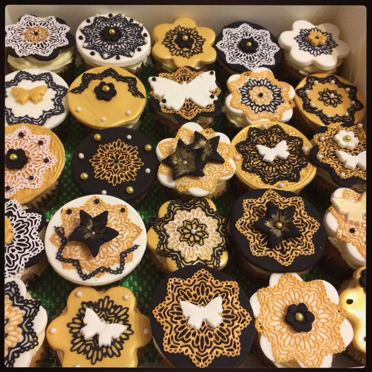More...black, white and gold cupcakes