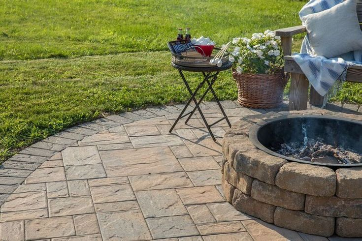 Check out this beautiful patio and fire pit installed using Cambridge Pavingstones with ArmorTec! Installation: Meyer for Hire