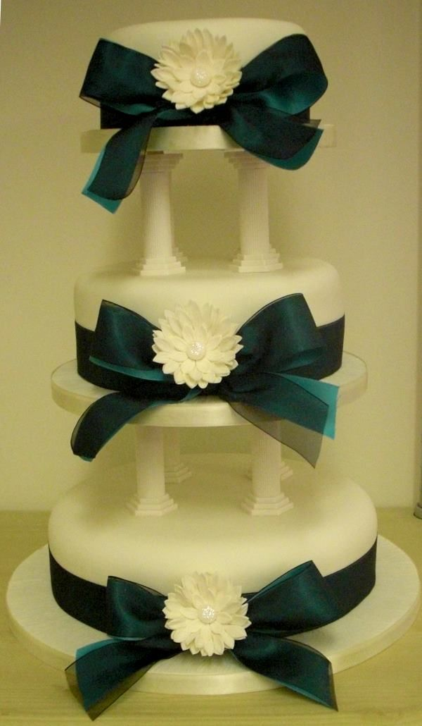 Wedding Cake On Pillars With Ribbons And Sugarcraft Flowers