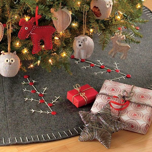 This Natural Wool Felt Chalet Tree Skirt is hand-sewn and hand-embroidered from wool, a natural fiber.