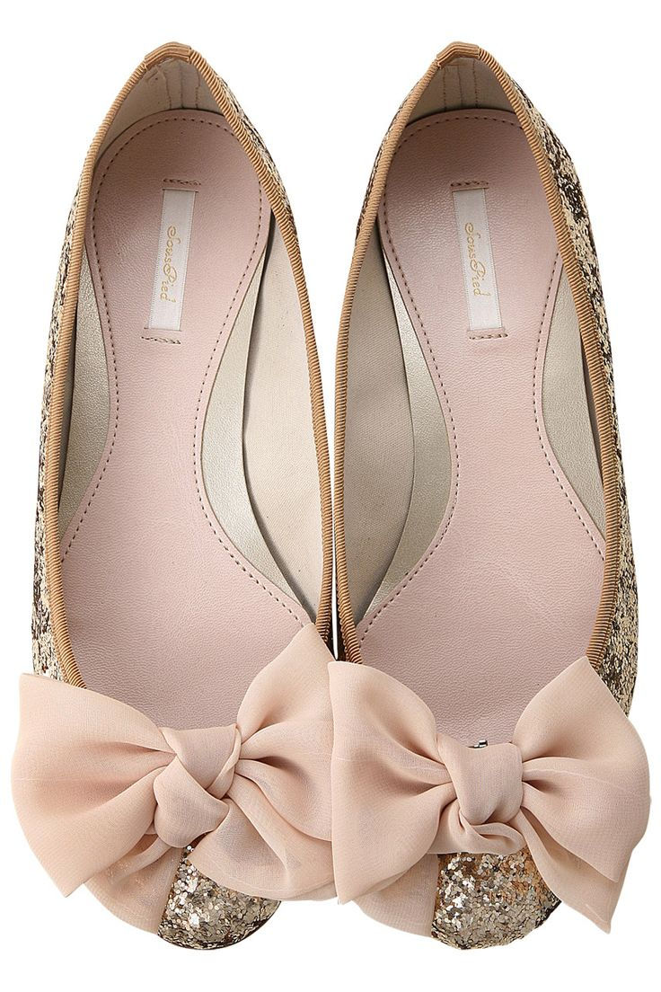 Gold and glitter flats with bows. So cute.