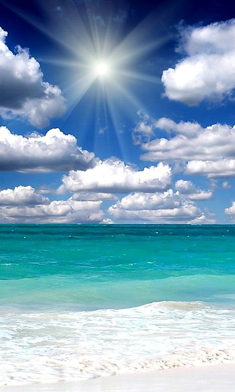 Big puffy white clouds, turquoise waters, and glorious sun rays shining down on it all.