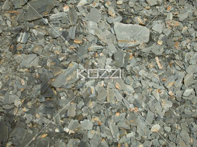 full frame of slates of textured stones. - Close-up full frame of slates of grey textured stones.