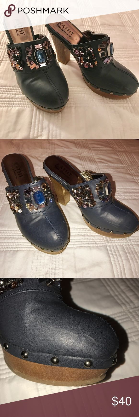 Kathy Van Zeeland Clogs Navy blue color! Only worn a few times. Minor flaws are shown in pictures. (Light scratches, normal wear signs on bottom and heel). Sequences and gems design. Tag says size 8 but fits like a size 7! Kathy Van Zeeland Shoes Mules & Clogs
