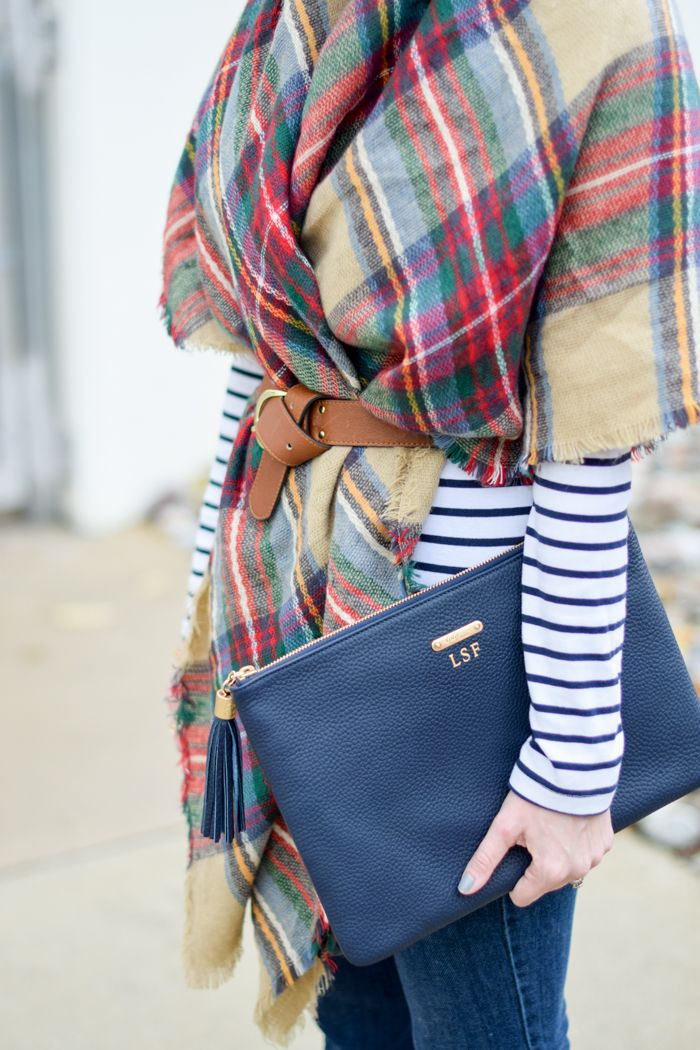 A monogrammed leather clutch.