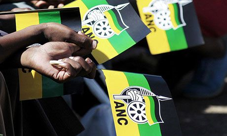 African National Congress supporters hold flags at a rally in Durban, South Africa. Photograph: Str/EPA