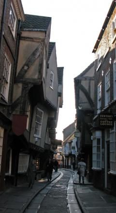 The Shambles, arguably the best preserved medieval street in the world.  It was mentioned in the Doomsday Book of William the Conqueror in 1086.  Many of the buildings on the street today date back to the late fourteenth and fifteenth century (around 1350-1475).In some sections of the Shambles it is possible to touch both sides of the street with your arms outstretched.