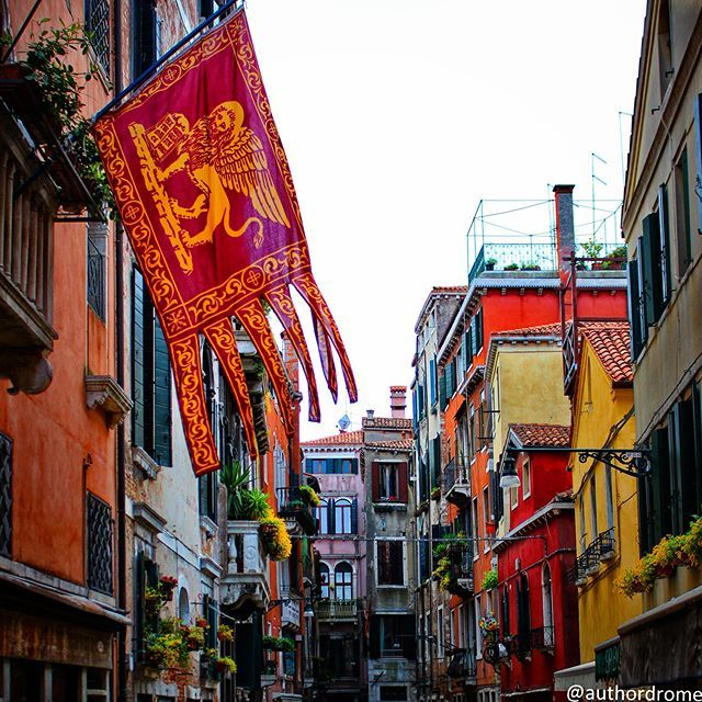 This city is like eating an entire box of chocolate liqueurs in one go. ● ● ● #authordrome #travel #travelgram #travelling #color #lion #flag #colorful #streets #venice #venezia #igersvenezia #ig_venice #veneziaunica #veneziadavivere #wu_europe #italy #ig